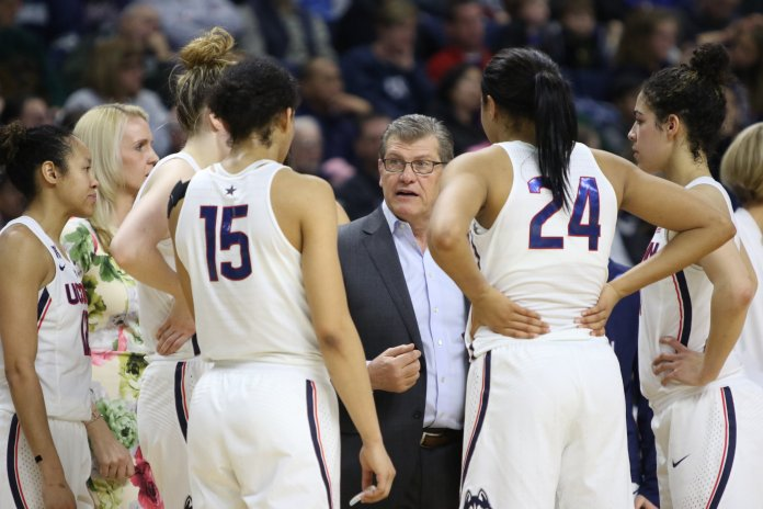 All four of UConn's All-American recipients (from left to right:Samuelson, Williams, Collier, and Nurse) surround Geno Auriemma during a timeout during the Huskies' Elite 8 win over UCLA. (Jackson Haigis/The Daily Campus)