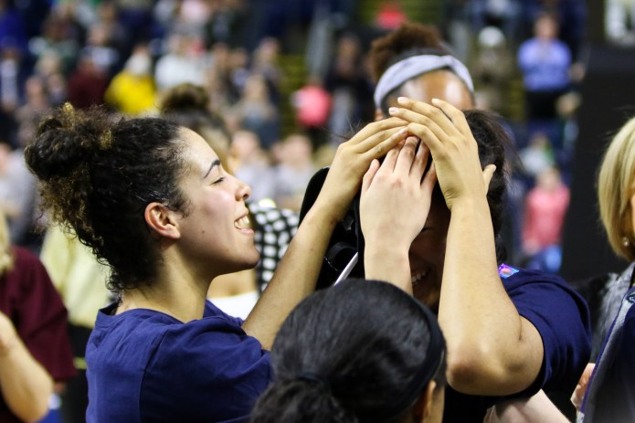UConn's Napheesa Collier is mobbed by her teammates after she was announced as the Most Outstanding Player of the Bridgeport Regional.