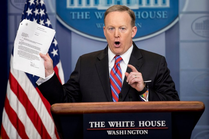 White House press secretary Sean Spicer holds up a document concerning a Washington Post story on Sally Yates as he talks to the media during the daily press briefing at the White House in Washington Tuesday, March 28, 2017. Spicer discussed the Supreme Court nominee Justice Neil Gorsuch, jobs, healthcare, and other topics. (Andrew Harnik/AP)