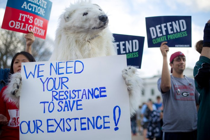 A demonstrator dressed as a polar bear joins others gather in front of the White House in Washington, Tuesday, March 28, 2017, during a rally against President Donald Trump's Energy Independence Executive order.Trump signed an executive order aimed at moving forward on his campaign pledge to unravel former President Barack Obama's plan to curb global warming. (AP/Pablo Martinez Monsivais)