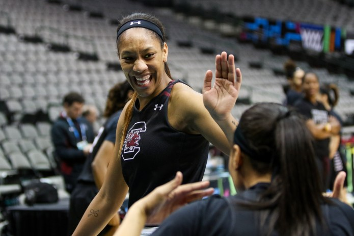 South Carolina forward A'ja Wilson celebrates with teammate Allisha Gray during the Gameocks' practice Thursday morning at the American Airlines Center in Dallas. (Jackson Haigis/The Daily Campus)