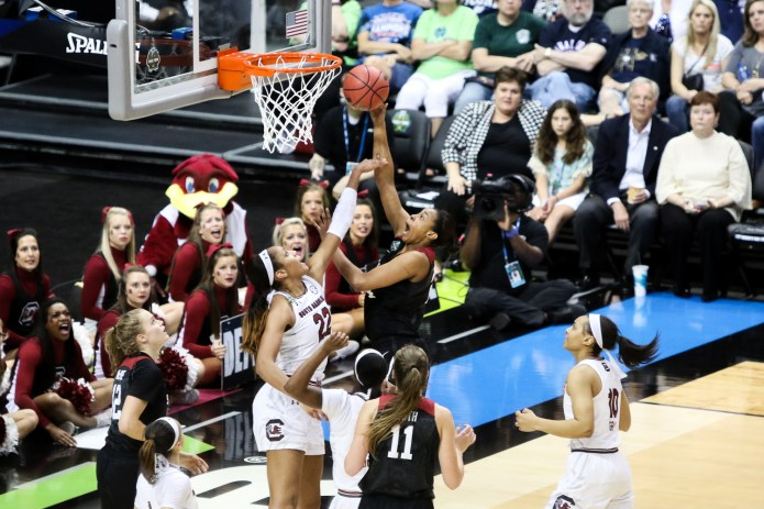4. Stanford senior Erica McCall leaps over South Carolina's A'ja Wilson in the first half of the teams' Final Four matchup on Friday, March 31, 2017 at the American Airlines Center in Dallas, Texas. (Jackson Haigis/The Daily Campus)