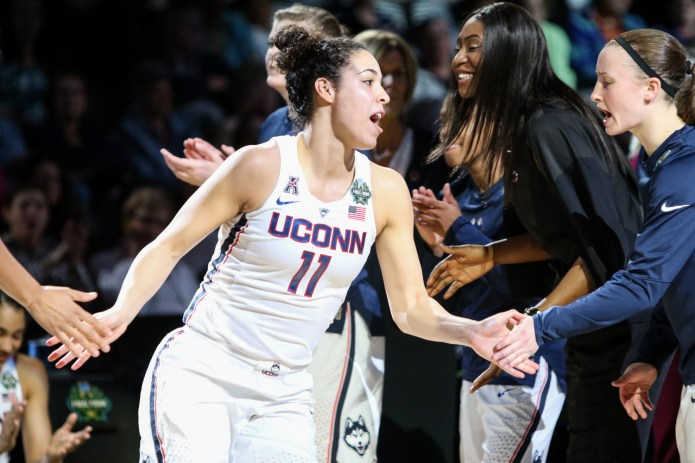 UConn guard Kia Nurse high-fives her teammates after getting introduced during warm-ups before the game.
