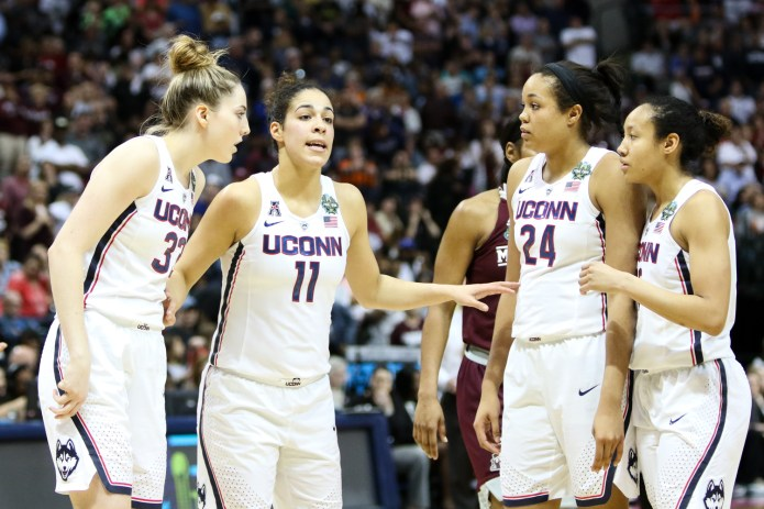 UConn guard Kia Nurse (second from left) goes over a play with teammates Katie Lou Samuelson, Napheesa Collier, and Saniya Chong.