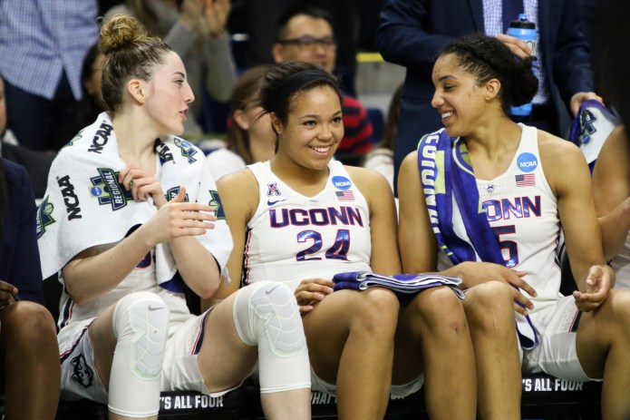 UConn's Katie Lou Samuelson, Napheesa Collier, and Gabby Williams celebrate on the bench during UConn's 90-52 win over Oregon in the Elite 8 on March 24, 2017 at Webster Bank Arena in Bridgeport, Connecticut. (Jackson Haigis/The Daily Campus)