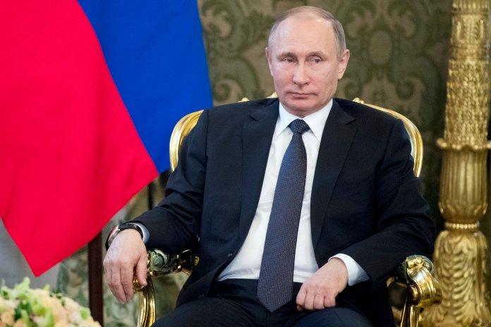 Russian President Vladimir Putin listens to Uzbek President Shavkat Mirziyoyev, during a meeting in Moscow's Kremlin, Russia, Wednesday, April 5, 2017. Mirziyoyev is in Russia on an official visit. (AP Photo/Pavel Golovkin, pool)