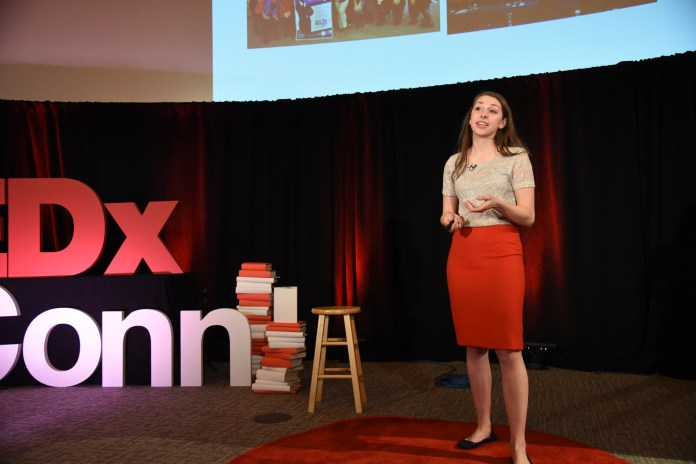 Senior Marissa Piccolo gives a TED talk about the importance of women in politics especially following this year's election on Sunday, April 9, 2017 in Laurel Hall. (Charlotte Lao/The Daily Campus)
