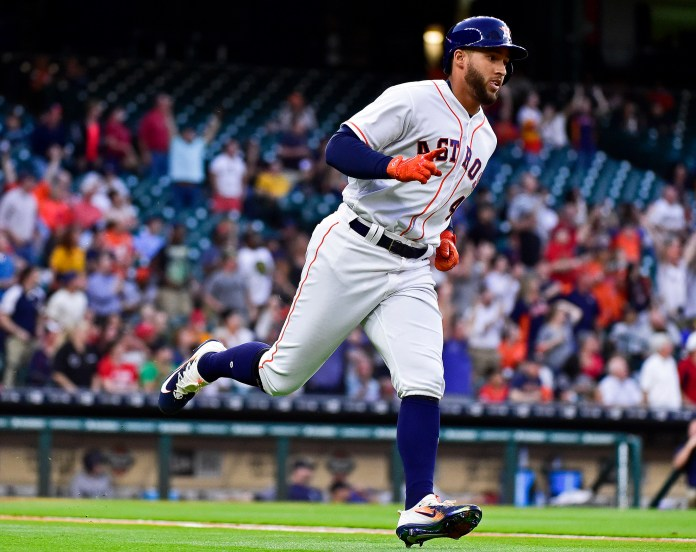 Houston Astros'George Springer rounds the bases after hitting a leadoff home run off Seattle Mariners starting pitcher Ariel Miranda during the first inning of a baseball game, Thursday, April 6, 2017, in Houston. (AP Photo/Eric Christian Smith)
