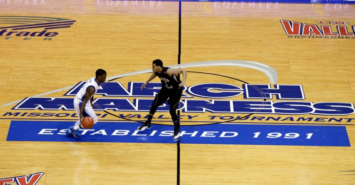 In this March 10, 2013, file photo, Creighton's Austin Chatman, left, brings the ball past half court as Wichita State's Demetric Williams defends in the first half of an NCAA college basketball game in the championship of the Missouri Valley Conference tournament, in St. Louis. The American Athletic Conference has voted to extend an invitation to Wichita State to join the league. Conference spokesman Bill Potter says the presidents of the conference's 12 member schools voted unanimously Friday, April 7, 2017, to admit the school in all sports but football. (AP Photo/Tom Gannam, File)