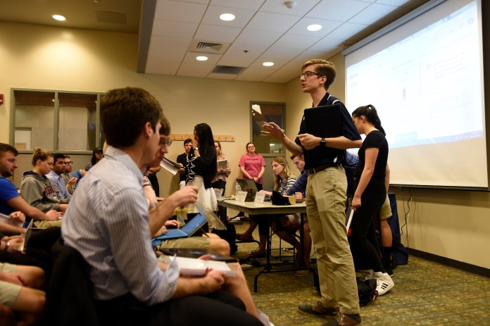 A special USG Senate was held on April 12 in Student Union Room 104. During the meeting, members voted in favor of allowing culture centers to participate in homecoming events and voted against mentioning Greek life in the budget cut proposal. (Jason Jiang/The Daily Campus)