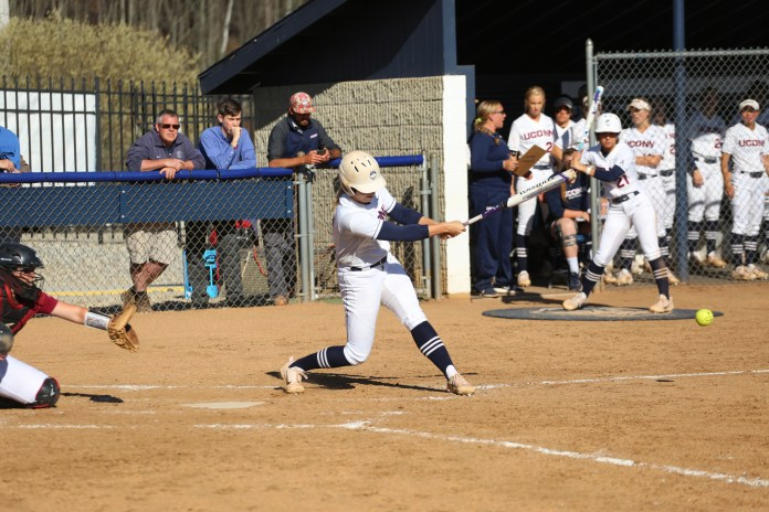 A UConn slugger sends the ball flying during the Huskies 7-1 victory over UMass-Amhest Minutewomen on Tuesday, April 18, 2017 at Burrill Family Field. (Tyler Benton/The Daily Campus)