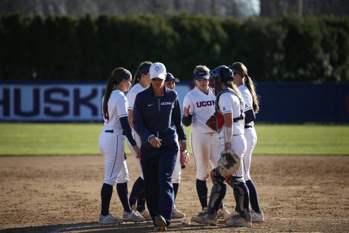 UConn softball head coach Jen McIntyre walks off the field after talking to her team.(Tyler Benton/The Daily Campus)