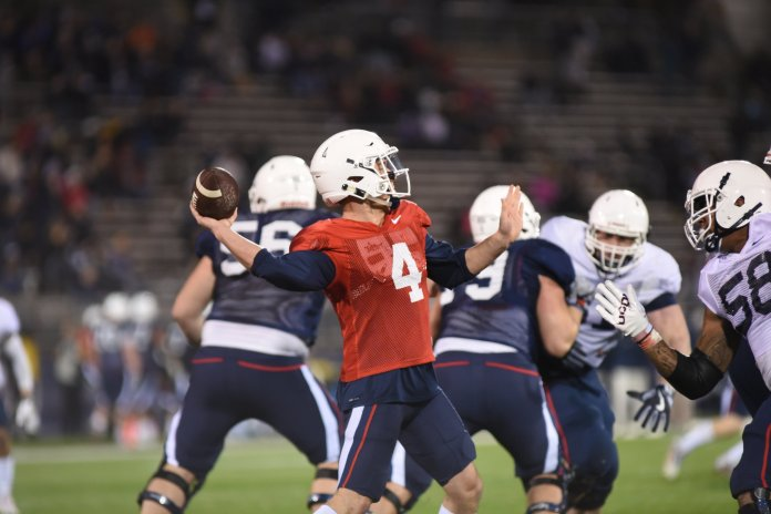 Quarterback Bryant Shirreffs (#4) drops back for a pass in the UConn Spring Game on April 21, 2017. (Charlotte Lao/The Daily Campus)