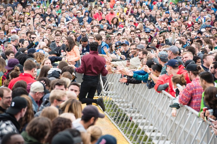 Francis Farewell Starlite high-fives the crowd while performing performs at the Boston Calling music festival on Saturday, May 27, 2017. (Photo courtesy 44 Communications)