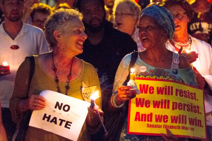 On Sunday, August 13, 2017, people marched in Savannah, Ga. at Savannah Taking Action for Resistance's candlelight vigil for victims of Charlottesville, Va. Similar marches took place across the country in the wake of a white supremacy rally on August 12. (Will Peebles/AP)