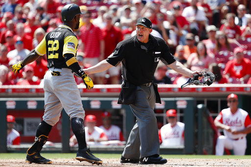 Pittsburgh Pirates' Andrew McCutchen argues a call with umpire Jeff Kellogg, center, in the fourth inning of a baseball game against the Cincinnati Reds, Sunday, Aug. 27, 2017, in Cincinnati. (AP Photo/John Minchillo)