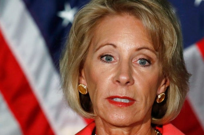 Education Secretary Betsy DeVos speaks about campus sexual assault and enforcement of Title IX, the federal law that bars discrimination in education on the basis of gender, Thursday, Sept. 7, 2017, at George Mason University Arlington, Va., campus. (AP Photo/Jacquelyn Martin)