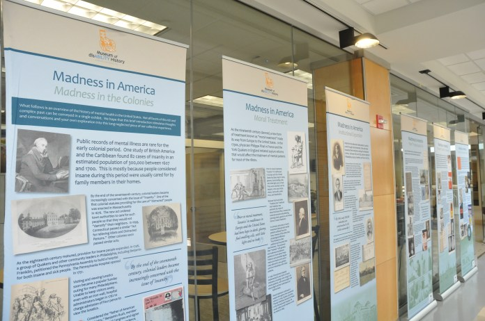 An exhibit in Wilbur Cross at the Center for Students with Disabilities depict the overview of the history of mental health. The panels will be on display until September 29. (Olivia Stenger/The Daily Campus)