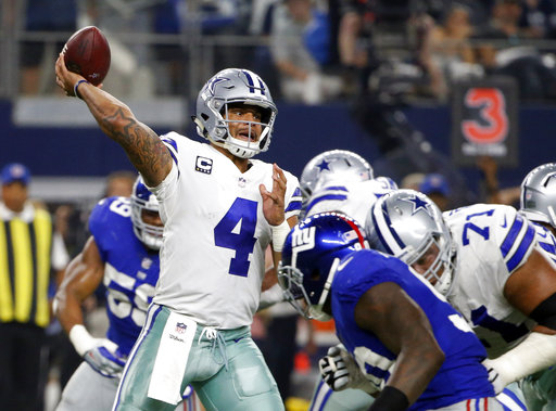 Dallas Cowboys quarterback Dak Prescott (4) throws a pass in the first half of an NFL football game against the New York Giants on Sunday, Sept. 10, 2017, in Arlington, Texas. (AP Photo/Michael Ainsworth)