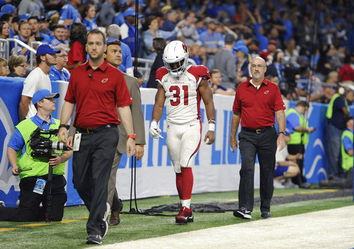Arizona Cardinals running back David Johnson (31) walks off the field with medical staff for X-rays during an NFL football game against the Detroit Lions in Detroit, Sunday, Sept. 10, 2017. (AP Photo/Jose Juarez)