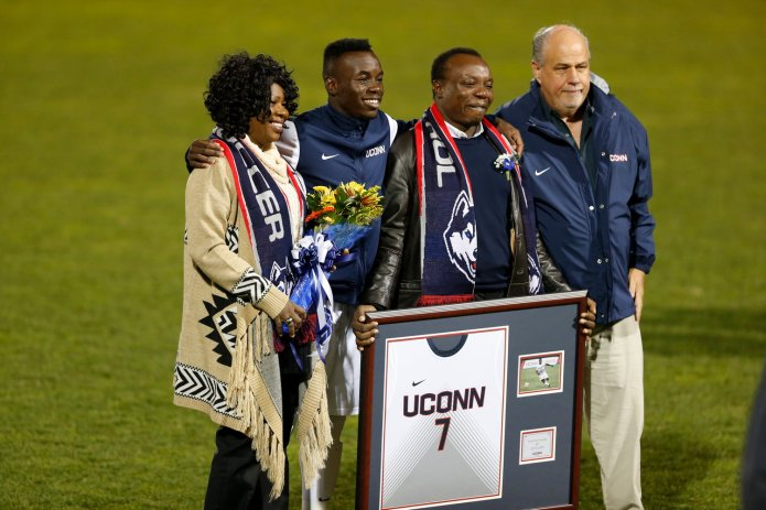 Ray Reid (far right) is pictured here with Kwame Awuah (far left). (File photo/The Daily Campus)