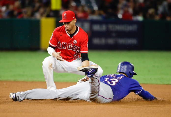Texas Rangers' Joey Gallo, right, is tagged out while stealing by Los Angeles Angels shortstop Andrelton Simmons during the seventh inning of a baseball game in Anaheim, Calif., Saturday, Sept. 16, 2017. (Chris Carlson/AP)