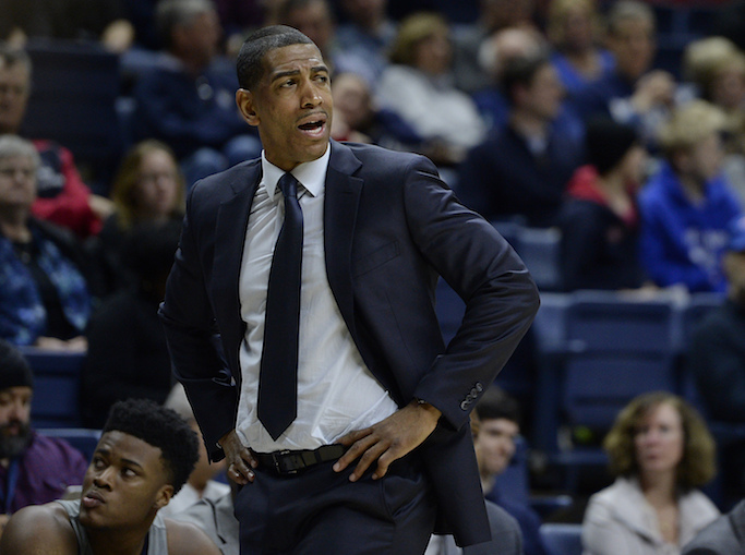 Connecticut coach Kevin Ollie reacts during the first half of the team's NCAA college basketball game against South Florida, Wednesday, Feb. 8, 2017, in Storrs, Conn. (AP Photo/Jessica Hill)
