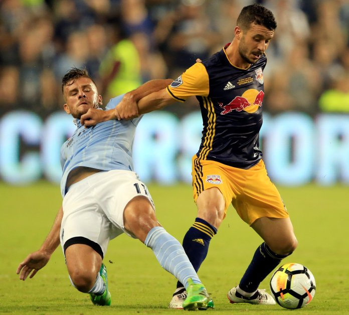 Sporting Kansas City forward Diego Rubio, left, tangles with New York Red Bulls midfielder Felipe Martins, right, during the first half in the final of the U.S. Open Cup soccer tournament in Kansas City, Kan., Wednesday, Sept. 20, 2017. (Orlin Wagner/AP)