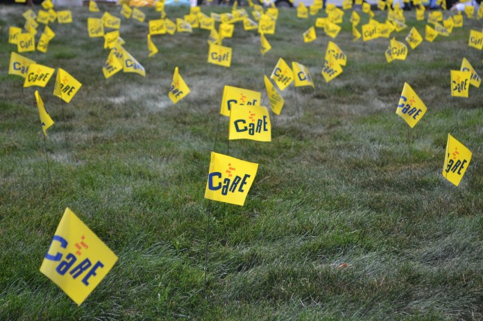 """During Suicide Prevention Week, from Sept. 25 through Sept. 29, the lawn in front of the Student Union is serving as a """"Field of Memory."""" To give students a way to visualize the impact suicide has on communities, one thousand yellow flags are stuck in the ground to represent all the lives lost. (Olivia Stenger/The Daily Campus)"""