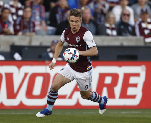 In this April 15, 2017, file photo, Colorado Rapids forward Kevin Doyle eyes the ball during the first half of an MLS soccer match in Commerce City, Colo. Doyle says he is retiring from professional soccer because of repeated concussions, according to a statement via social media on Thursday, Sept. 27, 2017. Doyle is from Ireland and has played 16 years both in Europe and in Major League Soccer. (AP Photo/David Zalubowski, File)