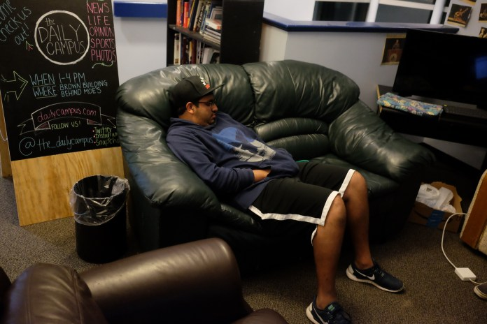 Don't be afraid to take a nap somewhere after a hard day of studying. The author is providing a great example above. (Jon Sammis/The Daily Campus)