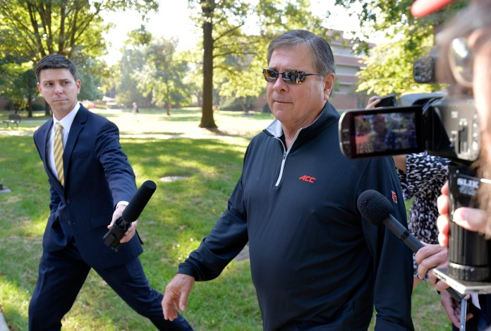 University of Louisville athletic director Tom Jurich arrives at the University's administration building for a meeting, Wednesday, Sept. 27, 2017, in Louisville, Ky. The university has scheduled a news conference Wednesday during which officials are expected to address the university's involvement in a federal bribery investigation, the latest scandal involving the Cardinals men's basketball program. (AP Photo/Timothy D. Easley)