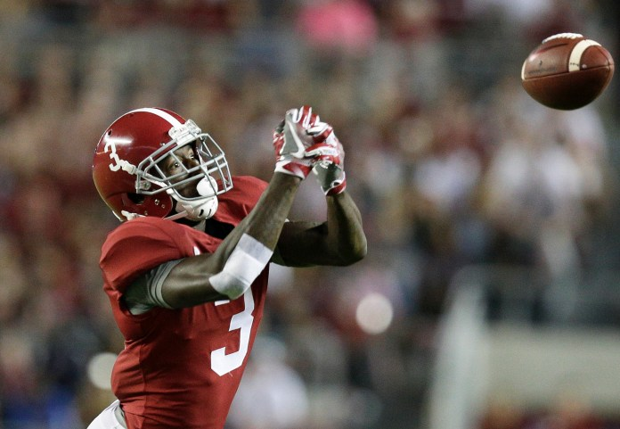 Alabama wide receiver Calvin Ridley misses the ball during the first half of an NCAA college football game against Mississippi, Saturday, Sept. 30, 2017, in Tuscaloosa, Ala.Alabama won 66-3. (AP Photo/Brynn Anderson)