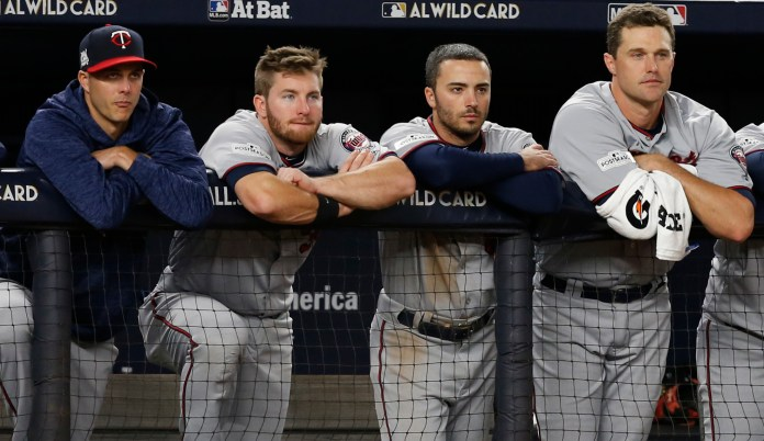 Minnesota Twins players watch during the closing innings of their 8-4 loss in an American League wild-card playoff baseball game against the New York Yankees in New York, Tuesday, Oct. 3, 2017. (AP Photo/Kathy Willens)