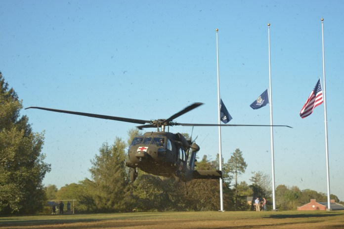 UConn Alumnus Christopher Gibb pilots the HH-60M Blackhawk helicopter takes off from the Veterans Memorial Field in a display of tactical prowess as the ROTC came to UConn on Wednesday Oct. 4 to meet with students on Fairfield Way. (Nick Hampton/The Daily Campus)