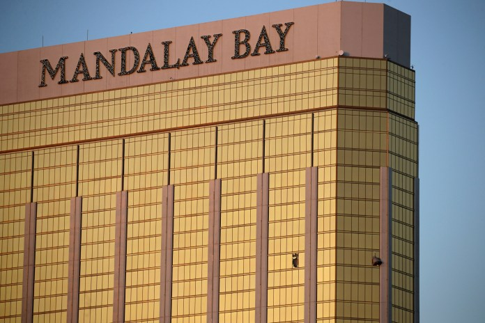In this Monday, Oct. 2, 2017 file photo, drapes billow out of broken windows at the Mandalay Bay resort and casino on the Las Vegas Strip, following a deadly shooting at a music festival in Las Vegas. Police who have yet to find Stephen Paddock's motive for the massacre said Friday, that they will enlist the public's help. The FBI's Aaron Rouse says billboards will ask people with credible information to call the agency at 800-CALL-FBI. (AP Photo/John Locher, File)