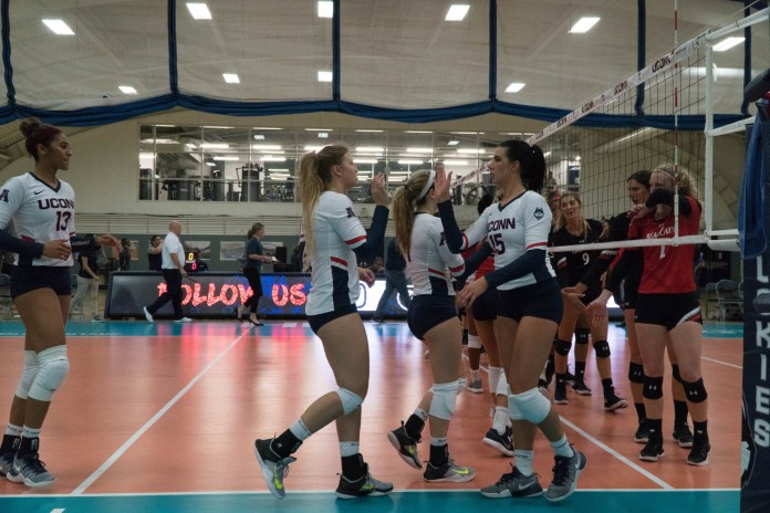 The UConn Women's Volleyball team put up strong sets but lost to Cincinnati 3-1 on Friday, October 6. (Eric Wang/The Daily Campus)