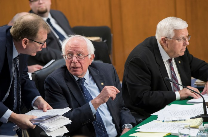 Sen.Bernie Sanders, I-Vt., the ranking member of the Senate Budget Committee, is joined at right by Chairman Mike Enzi, R-Wyo., as members vote on amendments during the markup of Senate's fiscal year 2018 budget resolution, on Capitol Hill in Washington, Thursday, Oct. 5, 2017. (AP Photo/J. Scott Applewhite)