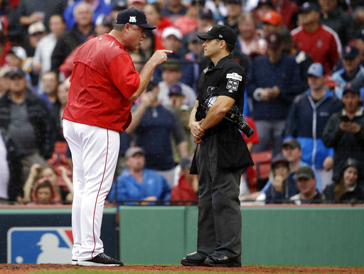 In this Monday, Oct. 9, 2017, photo, Boston Red Sox manager John Farrell, left, argues with home plate umpire Mark Wegner, right, during the second inning of Game 4 of baseball's American League Division Series against the Houston Astros in Boston.(AP Photo/Charles Krupa)