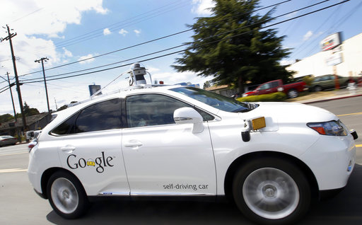 In this May 13, 2015, file photo, Google's self-driving Lexus car drives along street during a demonstration at Google campus in Mountain View, Calif. (AP Photo/Tony Avelar, File)