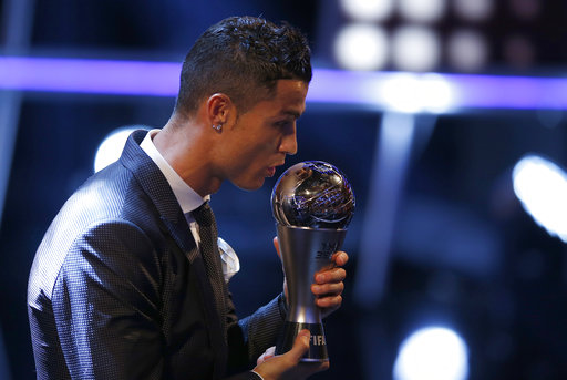 Portuguese soccer player Christiano Ronaldo holds the Best FIFA Men's player award during The Best FIFA 2017 Awards at the Palladium Theatre in London, Monday, Oct. 23, 2017. (AP Photo/Alastair Grant)