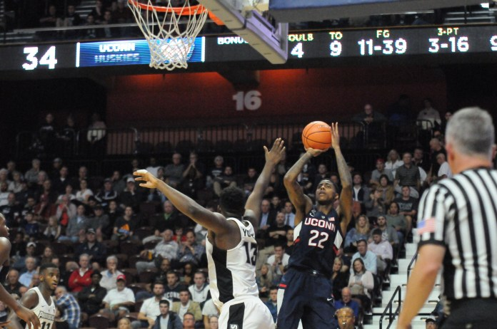 Terry Larrier (22) attempts a shot over a Providence College defender during the Huskies 90 to 76 loss to the Friars during an exhibition match to benefit hurricane victims in Mohegan Sun on Wednesday, Oct. 25, 2017. (Olivia Stenger/The Daily Campus)