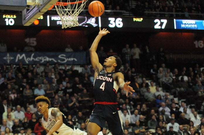UConn guard Jalen Adams (4) completes a layup during the Huskies 90-76 exhibition loss to the Providence College Friars on Wednesday evening in Mohegan Sun. (Olivia Stenger/The Daily Campus)