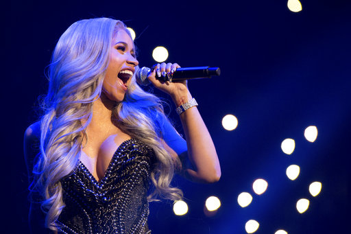 """In this Oct. 26, 2017 file photo, recording artist Cardi B performs at Power 105.1's Powerhouse at Barclays Center in New York. Cardi B and Offset from Migos are officially engaged. The """"Bodak Yellow"""" rapper was onstage with Offset at a Power 99 Powerhouse concert in Philadelphia when Offset dropped to one knee and pulled out a diamond ring. Cardi B excitedly waved her hands and jumped around before Offset put the diamond on her hand. (Photo by Scott Roth/Invision/AP)"""