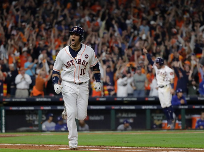 Houston Astros' Yuli Gurriel celebrates after hitting a three-run home run during the fourth inning of Game 5 of baseball's World Series against the Los Angeles Dodgers Sunday, Oct. 29, 2017, in Houston. (AP Photo/David J. Phillip)