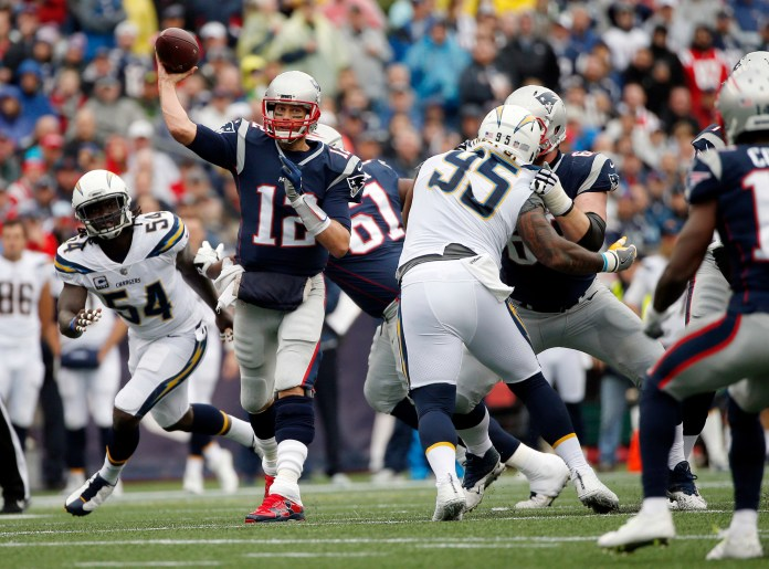 FILE - In this Oct. 29, 2017, file photo, New England Patriots quarterback Tom Brady (12) passes under pressure from Los Angeles Chargers linebacker Melvin Ingram (54) and defensive end Tenny Palepoi (95) during the first half of an NFL football game in Foxborough, Mass. (Michael Dwyer, File/AP)
