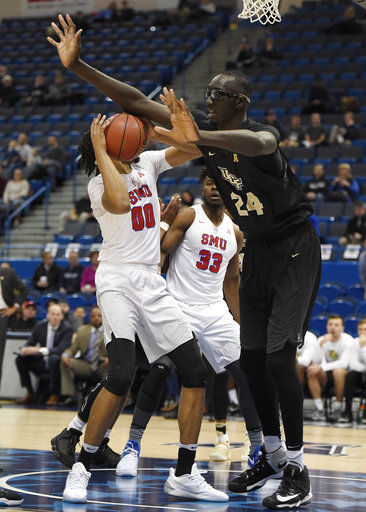 In this March 11, 2017, file photo, Central Florida's Tacko Fall, right, guards SMU's Ben Moore, left, during the first half of an NCAA college basketball game in the American Athletic Conference tournament semifinals, in Hartford, Conn.(AP Photo/Jessica Hill, File)