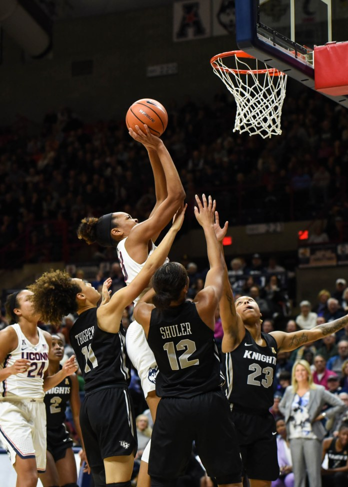 UConn forward Azurá Stevens goes up for a layup surrounded by three UCF defenders in the Huskies' 80-44 win over the Knights on Tuesday, Jan. 9 at Gampel Pavilion in Storrs, Connecticut. (Charlotte Lao, Associate Photo Editor/The Daily Campus)