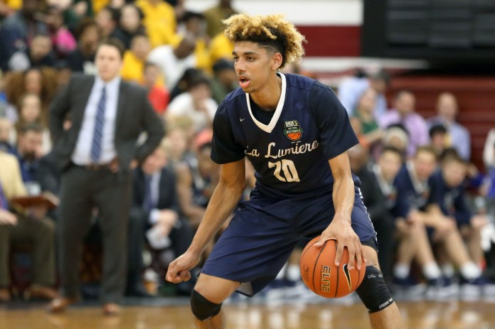 In this Friday, April 1, 2016 file photo, La Lumiere's Brian Bowen (20) moves the ball against Montverde Academy in the DICK'S Sporting Goods High School National Basketball Tournament in the Queens borough of New York. Suspended Louisville freshman Brian Bowen Jr. has signed to play with South Carolina. Bowen was held out of practices and games after Louisville announced it was being investigated as part of a federal corruption probe of bribery in college basketball that led to the firing of coach Rick Pitino. (Gregory Payan/AP)