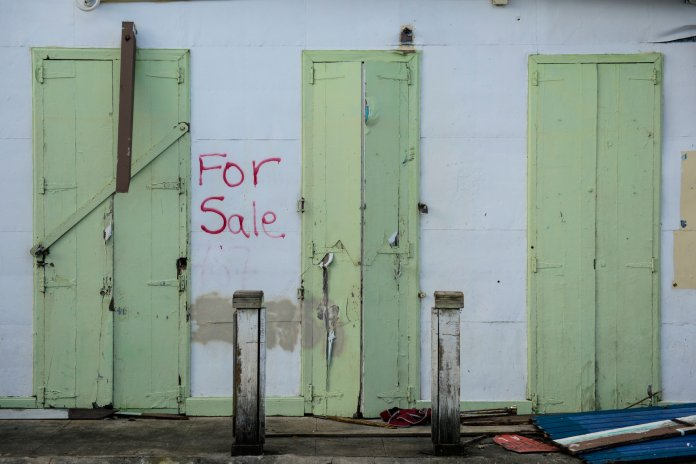 This Friday, Jan. 19, 2018 photo, shows one of multiple properties located in the Esperanza sector that are currently for sale, in Vieques, Puerto Rico. Hundreds of thousands of Puerto Ricans face losing their homes upon the expiration of a three-month moratorium on mortgage payments that banks offered after Hurricane Maria devastated the island. (AP Photo/Carlos Giusti)